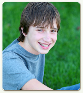 teen boy braces blue shirt